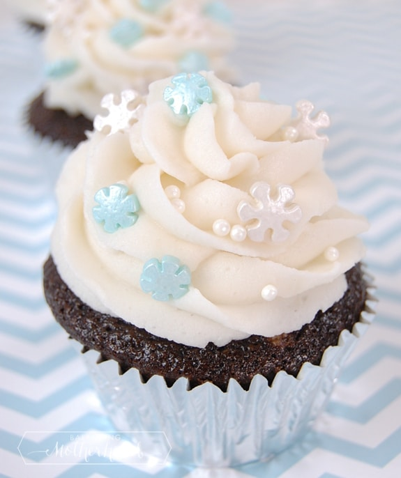 chocolate cupcake with vanilla buttercream and snowflake sprinkles on top via BalancingMotherhod.com