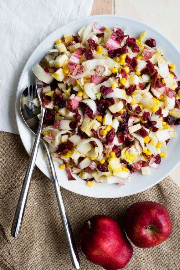 apple salad with corn and endive in bowl