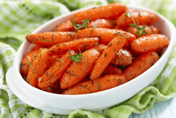 honey carrots in white dish