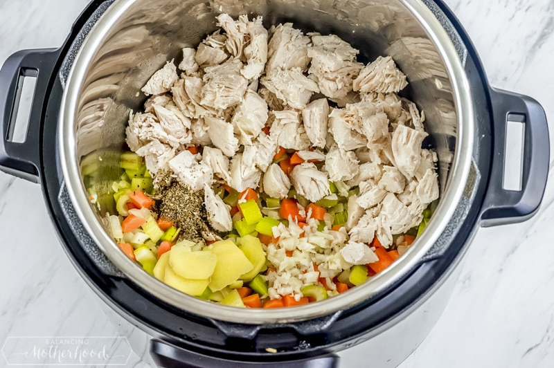 add chicken with chopped vegetable in the Instant Pot