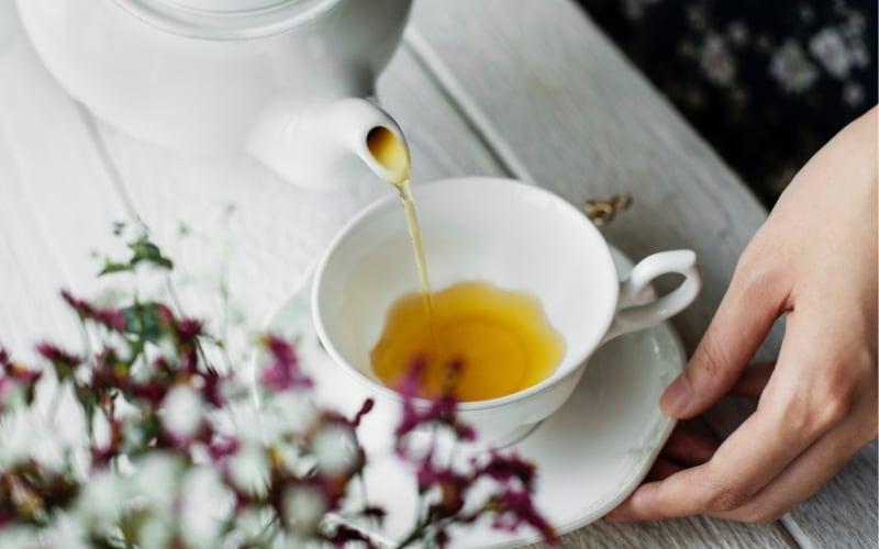 tea pot pouring mother's milk tea into tea cup