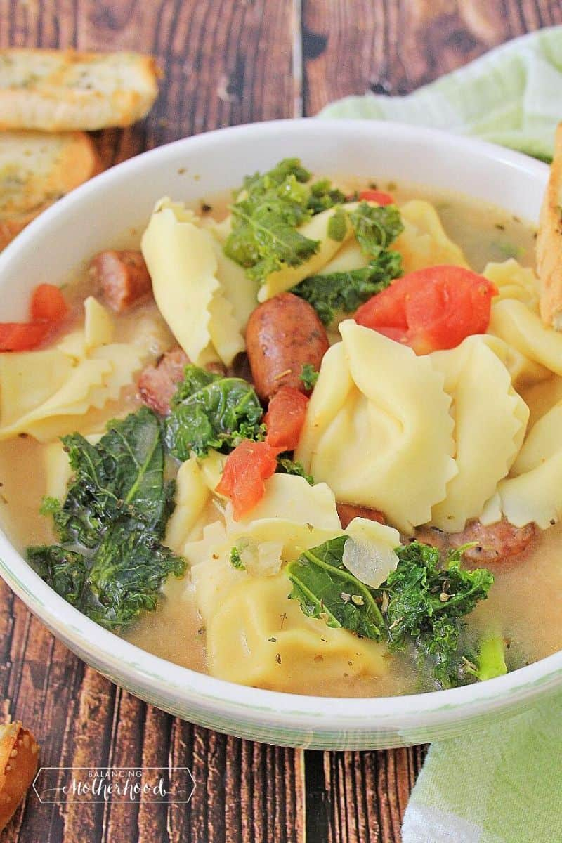 sausage tortellini soup in white bowl