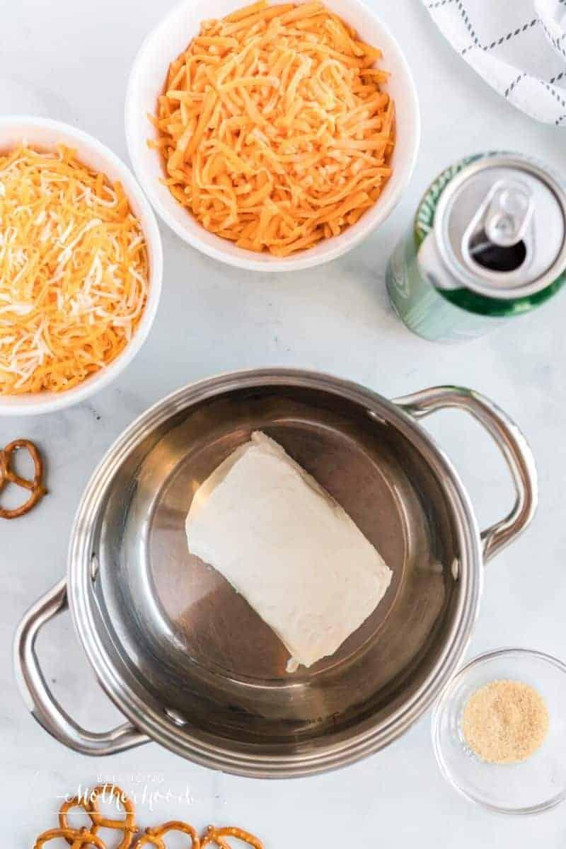 cheeses, beer, pretzels and a pot