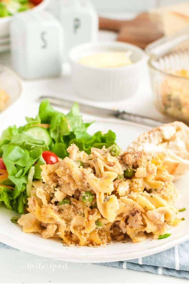 plate of tuna noodle casserole with side salad