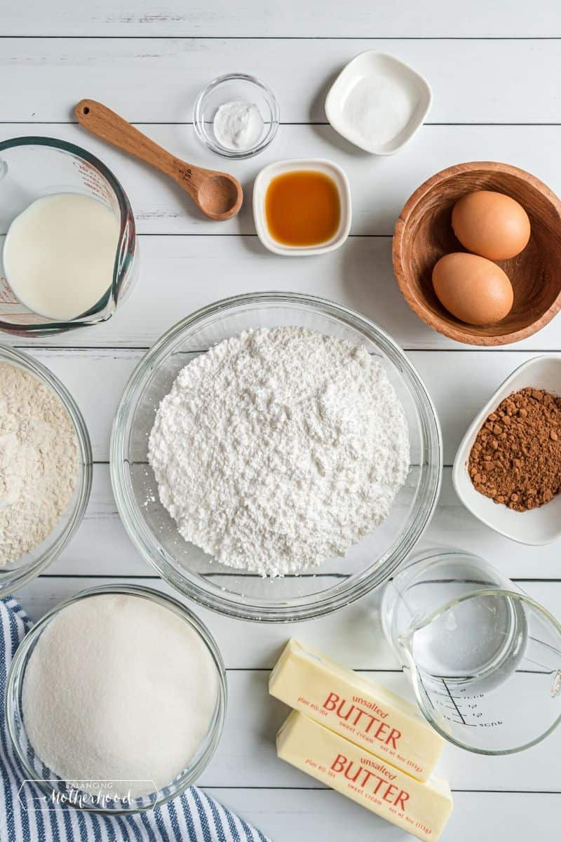 butter, bugar, flour, eggs and other ingredients on table