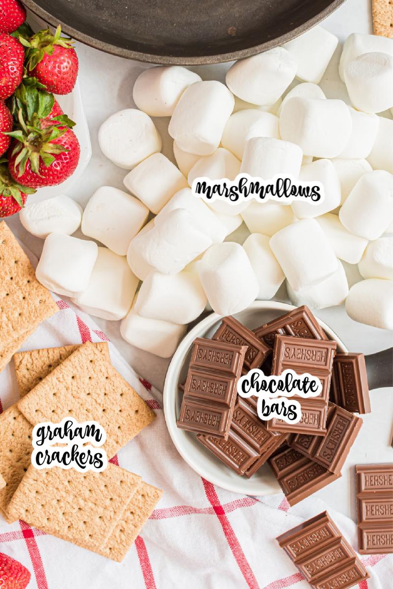 marshmallows, chocolate bars, strawberries, and graham grackers