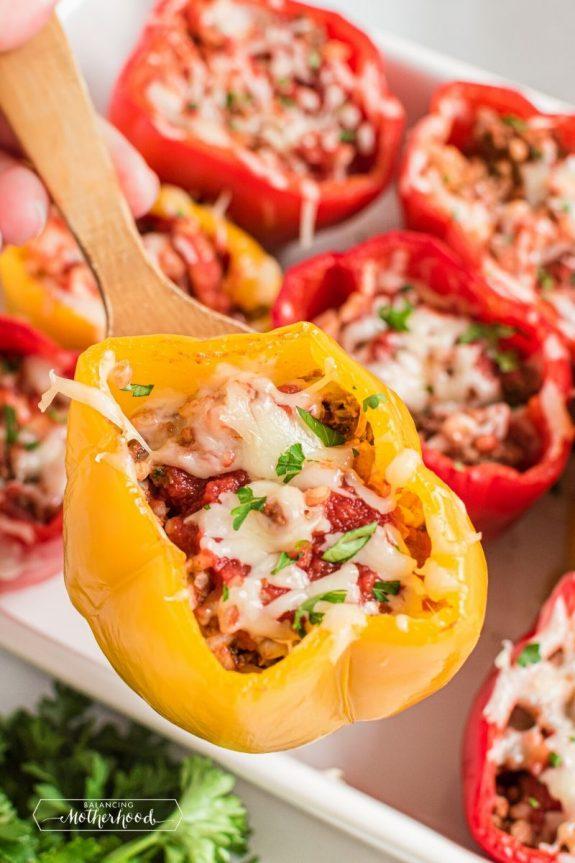 Stuffed bell peppers in casserole dish.