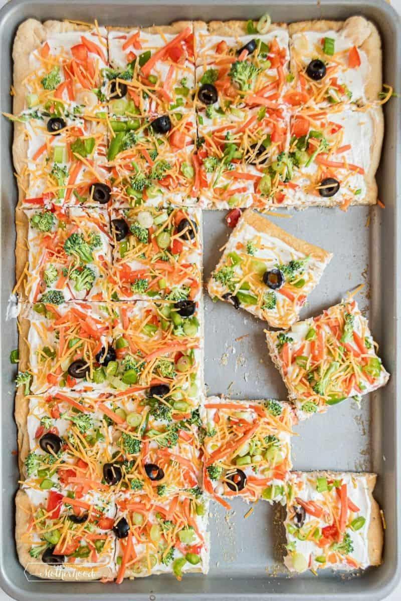 Top down photo of sliced veggie pizza.