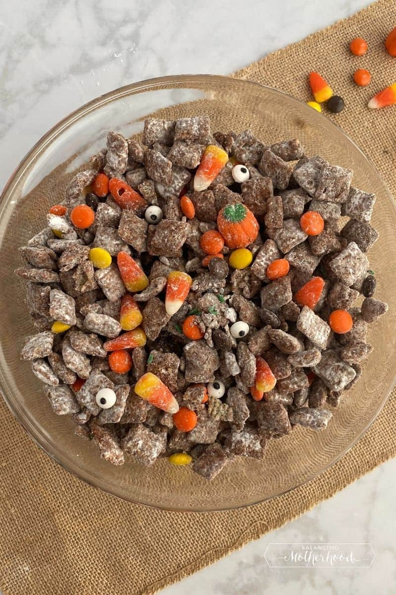 bowl with covered rice cereal and Halloween candies