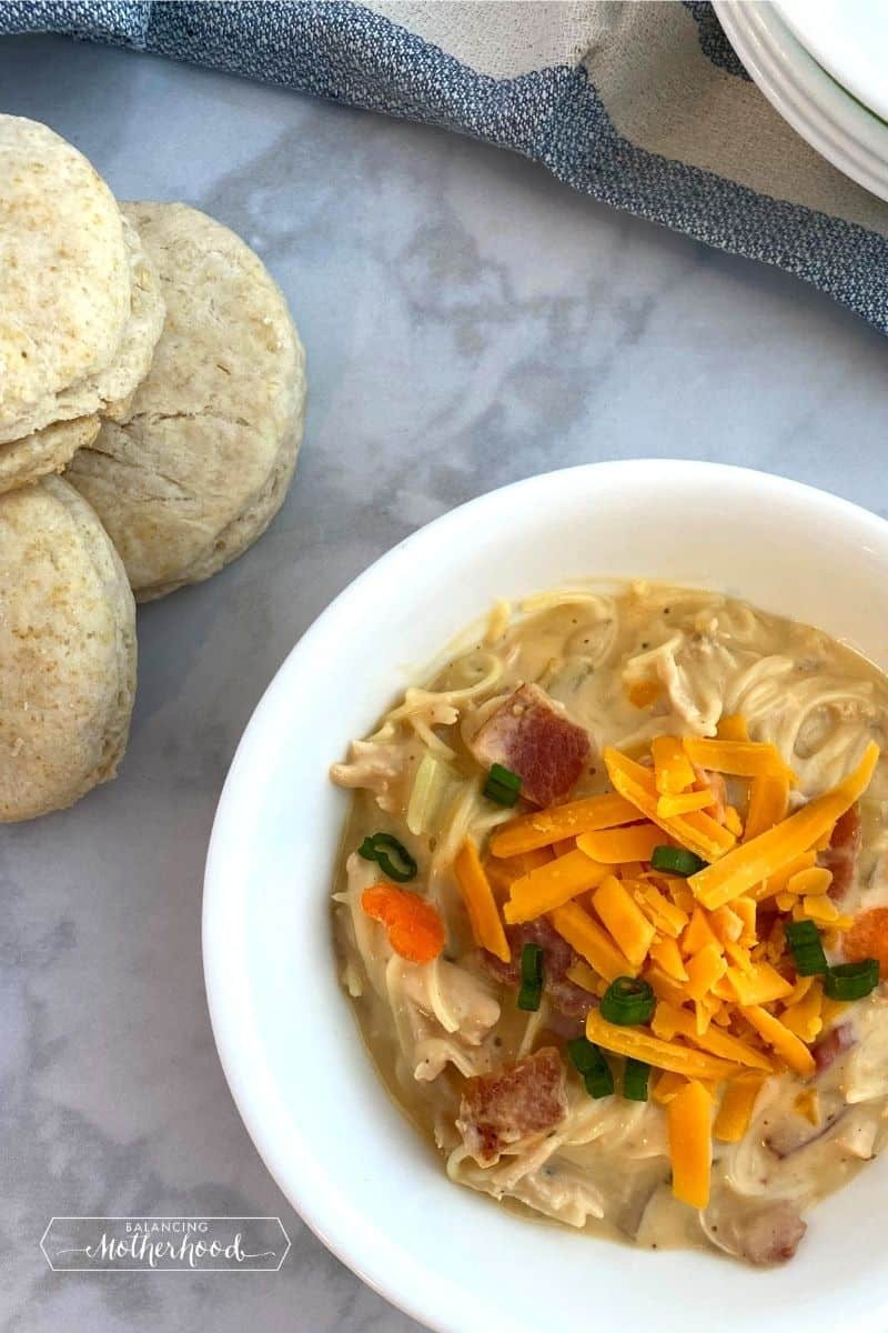 Bowl of chicken crack soup with biscuits.