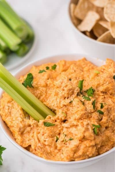 chicken dip in bowl with celery