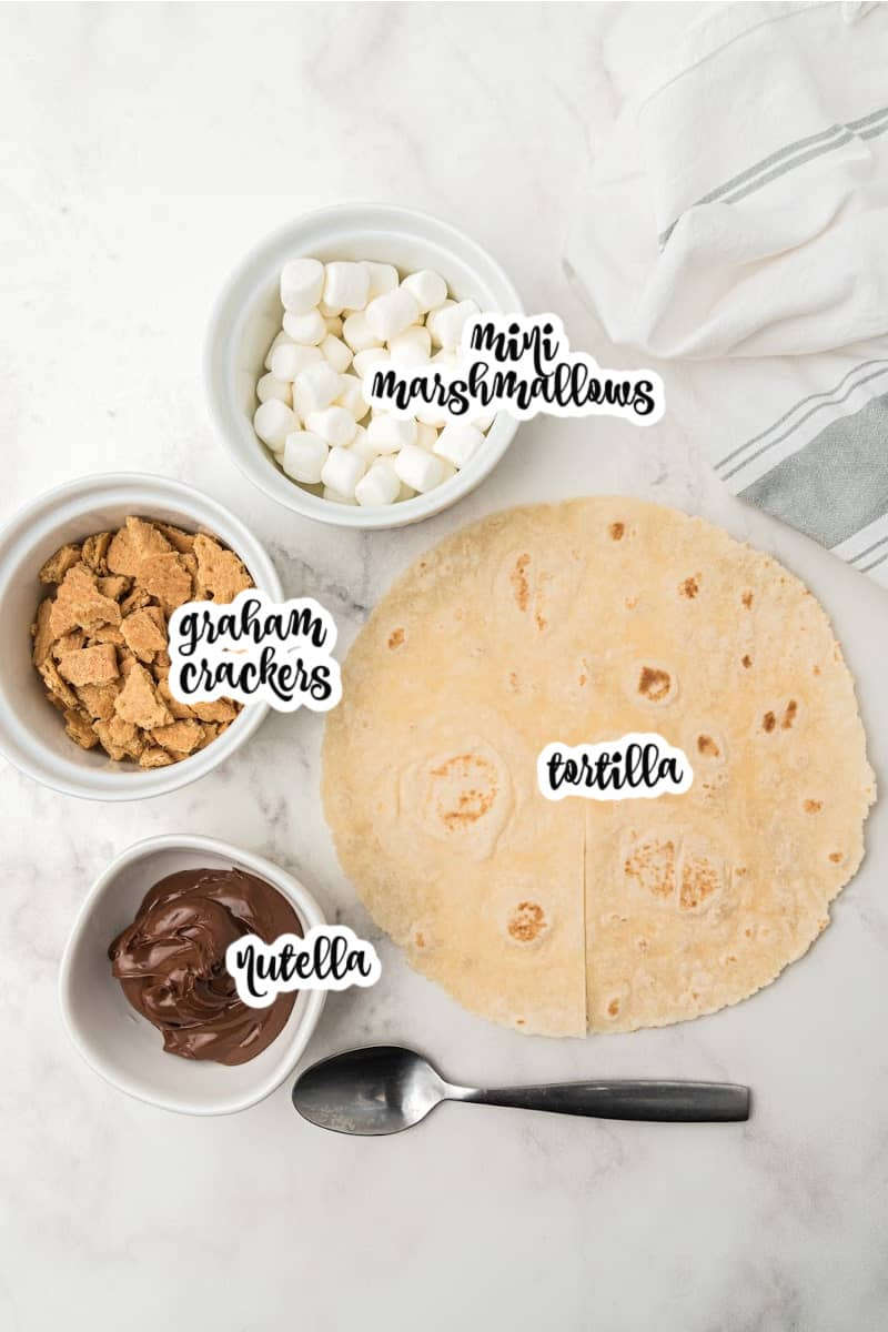s'mores tortilla ingredients: tortilla, nutella, mini marshmallows, graham crackers