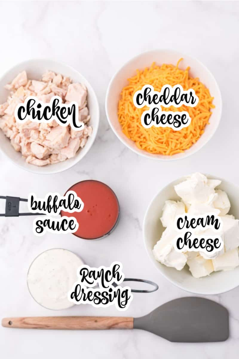 Crockpot buffalo chicken dip ingredients: chicken, cheese, buffalo sauce, cream cheese, Ranch