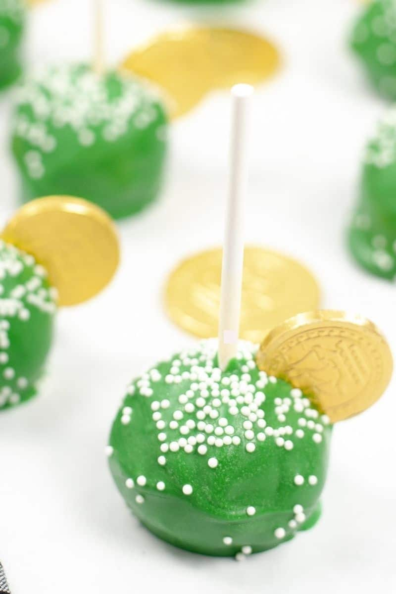 green st. patrick's cake pops with gold chocolate coin on side