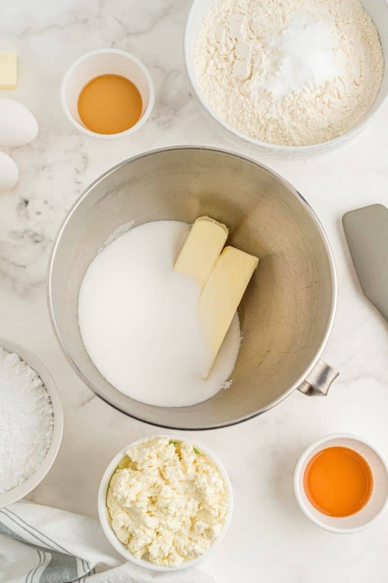 cookie ingredients: butter and sugar, eggs, vanilla, ricotta cheese