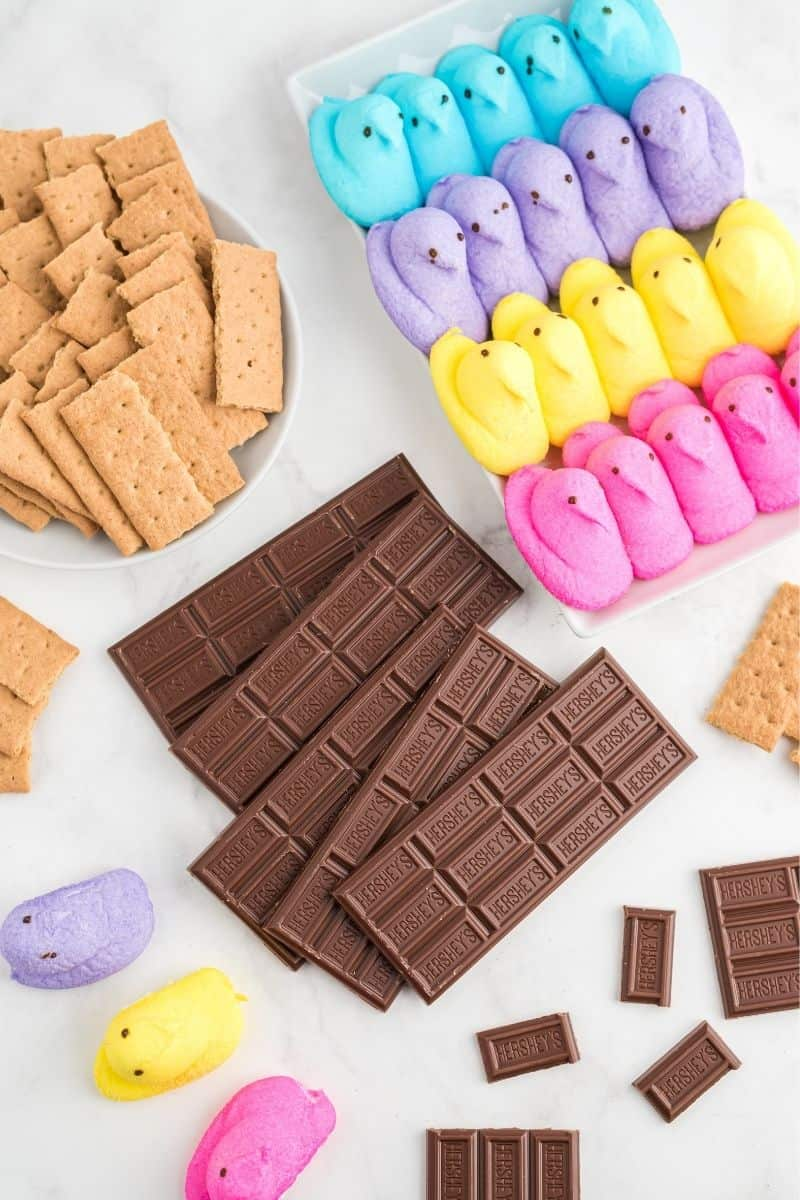 graham crackers, colored peeps, Hershey's chocolate bars on table